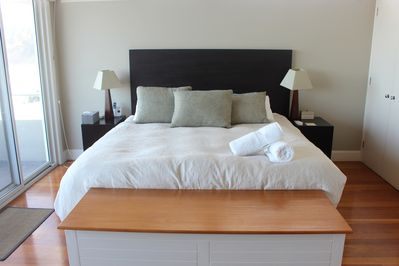The spacious master bedroom comes with an en-suite and private balcony