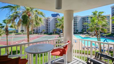Sunny Gulf-front condo with AC, ocean views, and shared pools/hot tub - dogs OK!