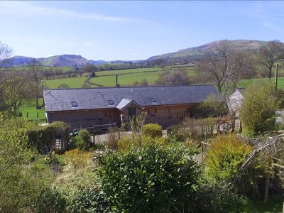 Photo for This pretty holiday cottage is set in open countryside, rolling hills, and is a haven of peace and t