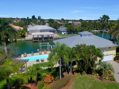 Photo for 5 Bed, 4 Bath Luxury Waterfront Pool Home, 2 Masters, 5 Min Walk to Beach