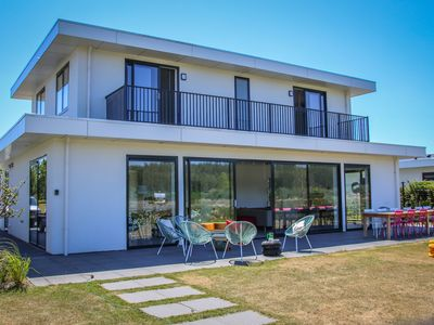 Photo for Beautiful designer villa by the water, in luxurious holiday park near Harderwijk
