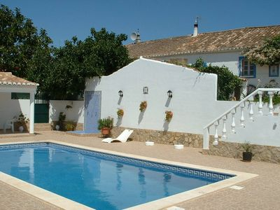 Photo for Traditional apartment on a beautiful plot with pool near the sea
