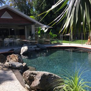 Photo for Private resort style home, set in tropical gardens with huge lagoon pool