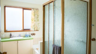 Bathroom with bathroom with seperate shower