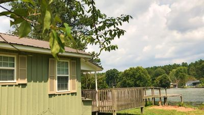 Photo for Dockside Cottage- directly on a small stocked lake. Wi-fi and cable free!
