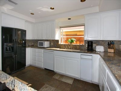 Gormet kitchen with granite counters and quality appliances.