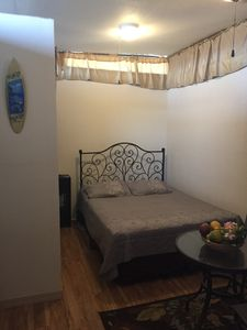 Queen size bed and small dining area inside. Additional dining area is outside.