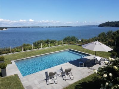 Photo for Amazing location with beautiful pool and water views Sunset Beach