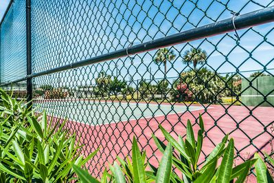 Shared tennis court at By The Sea Condominiums