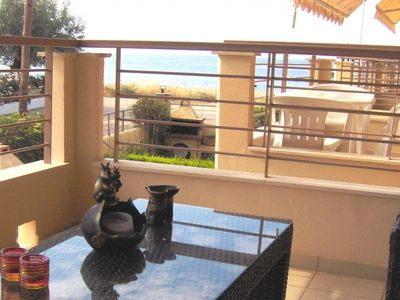 Photo for Sunny maisonette in seafront complex..
