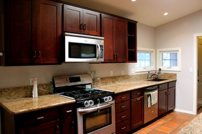 Updated kitchen with granite countertops and stainless steel appliances