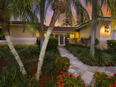 Photo for Stunning 5 br, 5 bth home on private golf course setting.  1 1/2 miles to beach.
