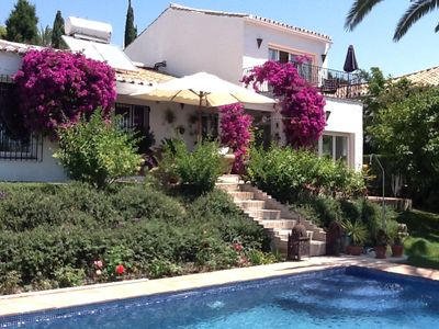 Photo for Beautiful 4 Bedroomed villa set in tropical gardens. Walking distance to the sea