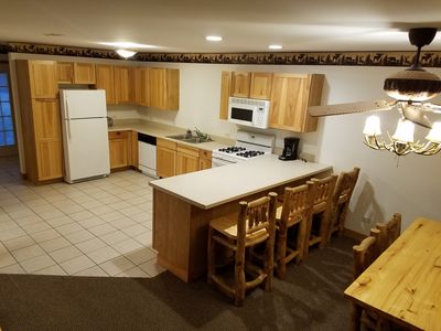 Large personal kitchen loaded with all major appliances and cookware.