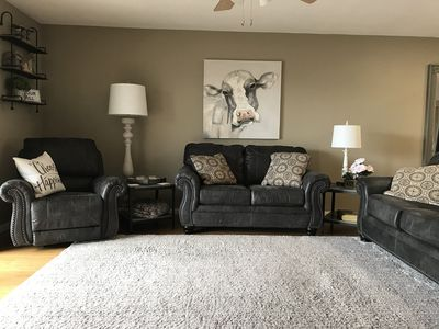 Living Room with Sofa Sleeper, Recliner and Love Seat.