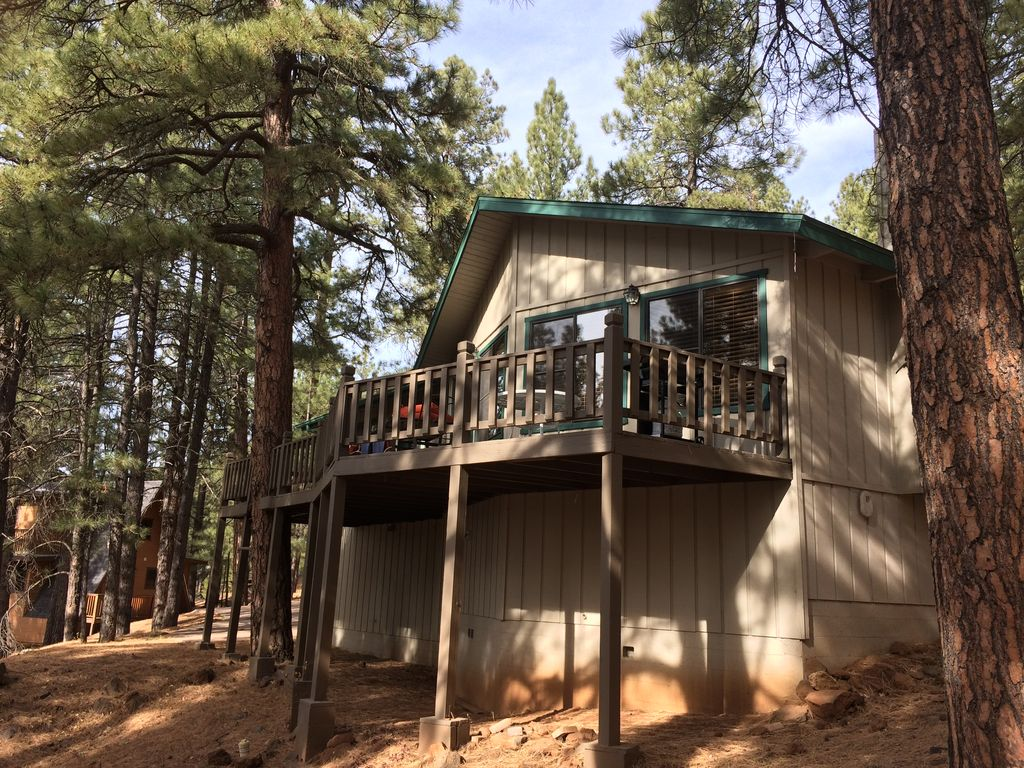 nestled property the rentals ha cabin elk arizona little flagstaff tall cabins lodge in pines