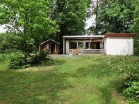Collected key easily. The bungalow was in a delightful position in the woods. Th ...
