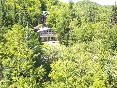 Aerial view of house and surrounding property