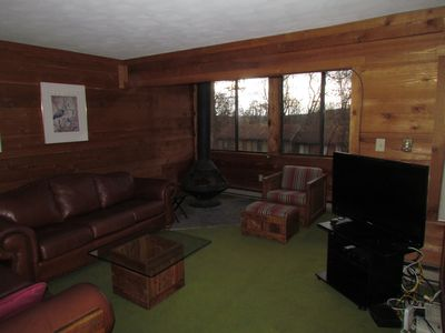 Living room with operational wood stove