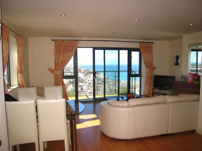 Photo for 2 Bedroom Apartment With Stunning Panoramic Sea Views And Indoor Pool .