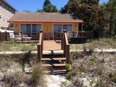 4 Steps to the white sand Beach.  Large deck with half sun and half shade.