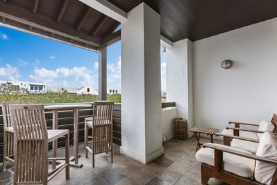 Balcony  - Enjoy conversations on a private balcony with plush outdoor seating and tables.