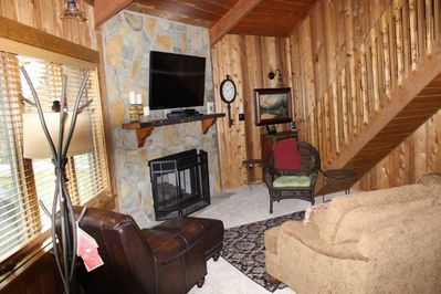 Family room with gas fireplace, 55' TV, cable, DVD, and more.