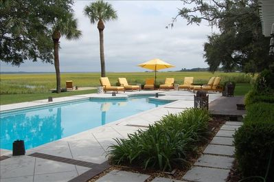 Pool with 8 lounge chairs and Marsh Views
