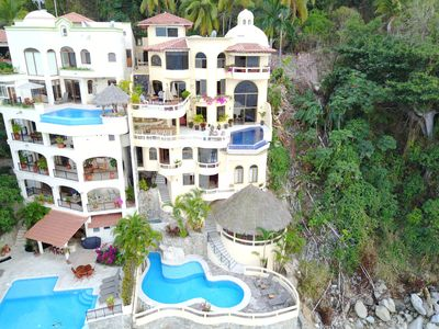 Photo for Beach Front Villa 2 Pools, Intrnl Chef Amazing Views Full Staff