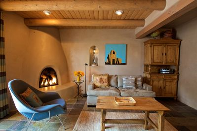 Living room, with gas-fired Kiva fireplace and down-filled soft.