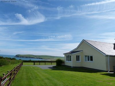 Photo for This peaceful cottage looks out over fields down to Newport Bay on the idyllic Pembrokeshire coast.