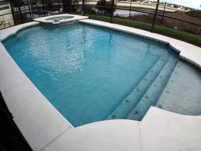 Photo for Pet Friendly, 3 Miles to Disney, pool/spa water view, fully tiled, fab home