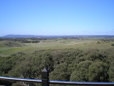 The view from the top deck over golf course and farms to Arthurs seat.