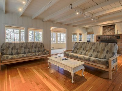 Photo for Lakeview home w/ deck, outdoor fireplace & sunset views - steps to sandy beach!
