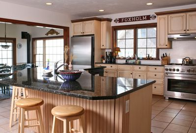 Fully stocked kitchen with water views all around.