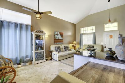 Spacious living room with ceiling fans.