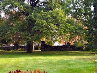 View of front yard and stone wall along High St.