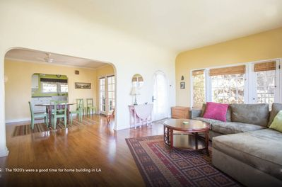 Spacious living and dining area with high ceilings and open floor plan