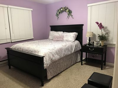 Queen size bed with plenty of storage place, alarm clock, TV & DVR