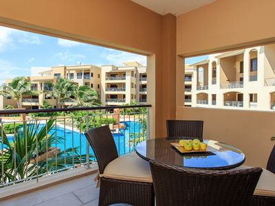 Photo for NEW LISTING! Upscale condo with shared pool and gym, near the beach