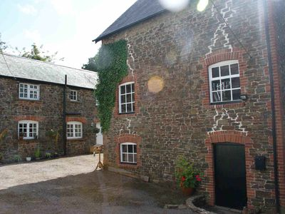 Photo for Historic Watermill Cottage between Dartmoor and Exmoor with 4 acres of parkland