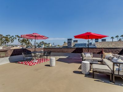Photo for Beach house with rooftop deck perfect for entertaining