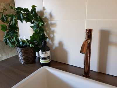 Copper mixing tap and porcelain sink