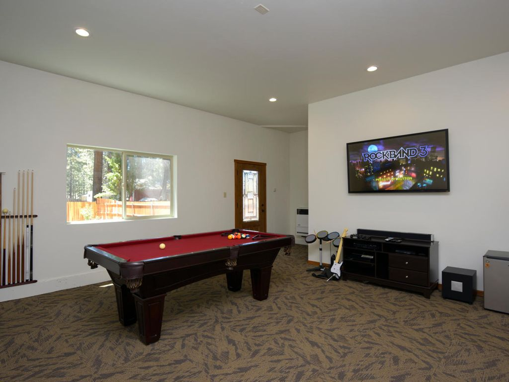 Retreat by the lake outdoor spa game room city of for Big game room