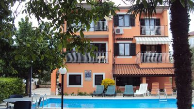 Photo for Holiday apartment with shared pool and garden