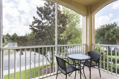 The screened in balcony allows you to enjoy the Florida breeze