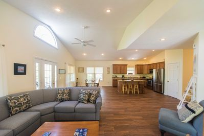 The Great Room with 12.5 foot vaulted ceilings and lots of windows