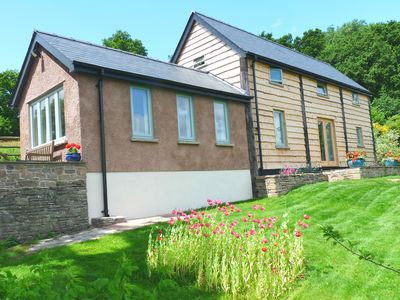 Photo for Luxury modern barn - quiet, lovely grounds, stunning views of nearby Crickhowell