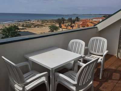 Photo for Penthouse Apartment With Shared Pool And Panaromic Sea Views Along The Beach