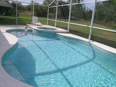 Photo for Golf Course View    4 Bedroom Vacation Pool Home Near Disney